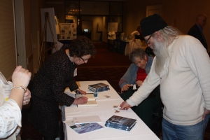 Dr. Carolyn Roy-Bornstein signs books after the keynote address.