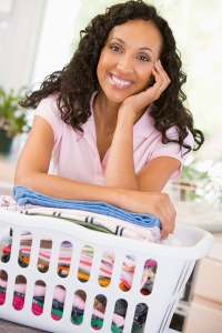 Woman Leaning On Washing In Basket