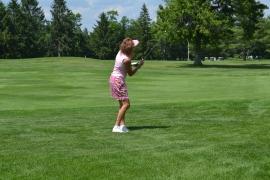 Golfer tees off
